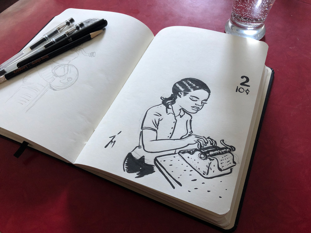 Photo of a sketchbook on a table.