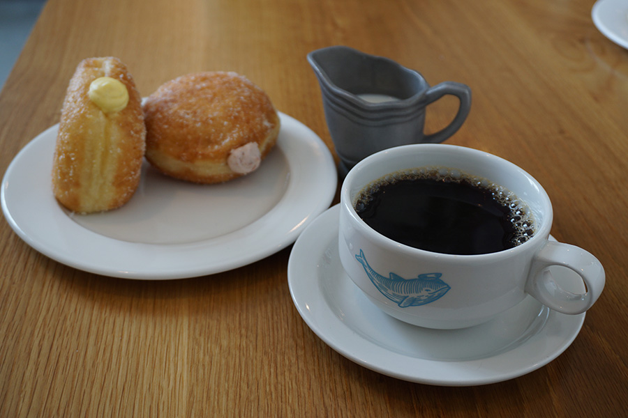 Photo of a coffee cup and custard filled doughnuts in Seattle.